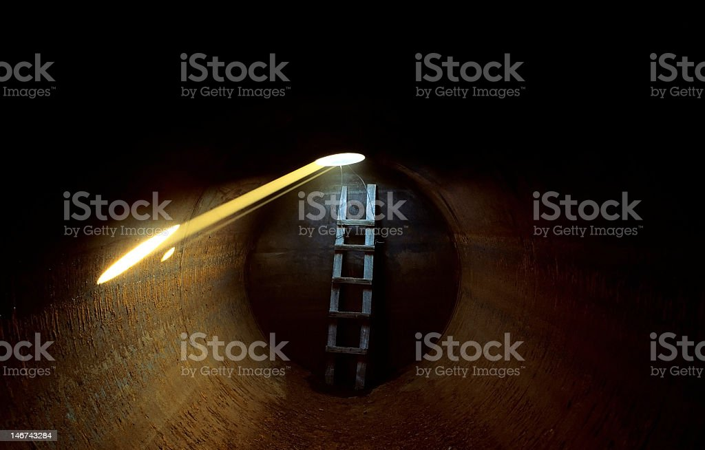 Image of a tunnel with a ladder stock photo