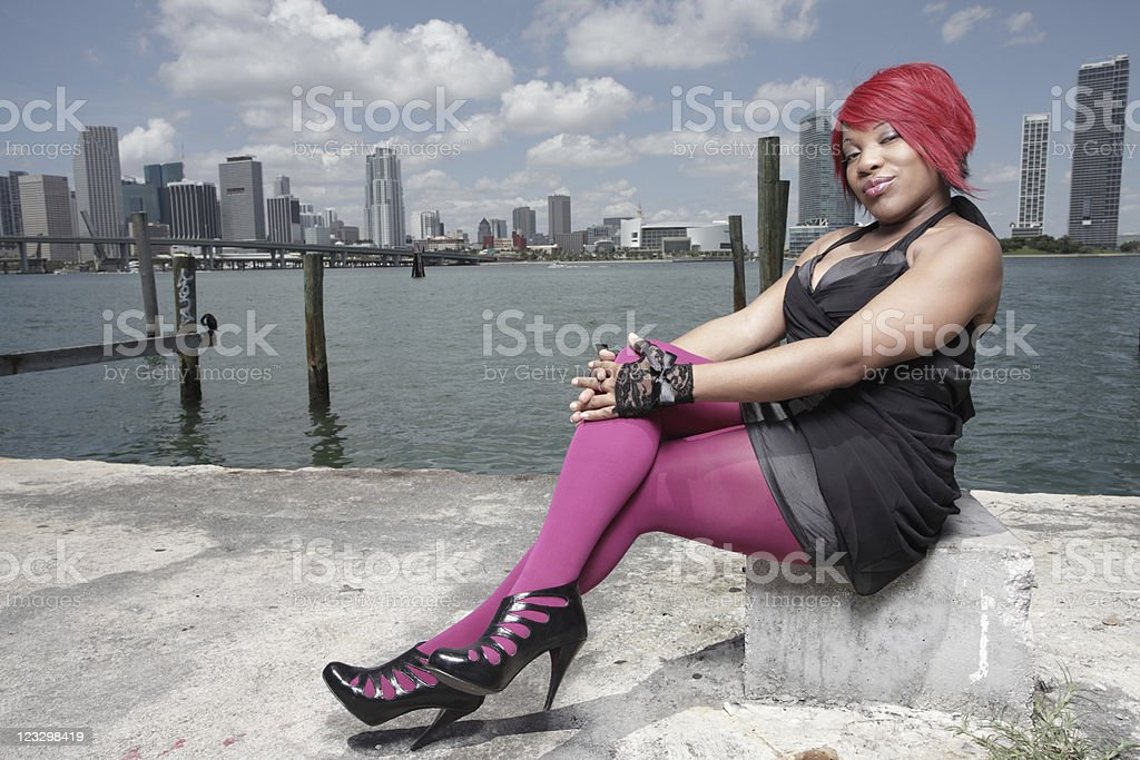 Image of a woman sitting by the bay royalty-free stock photo