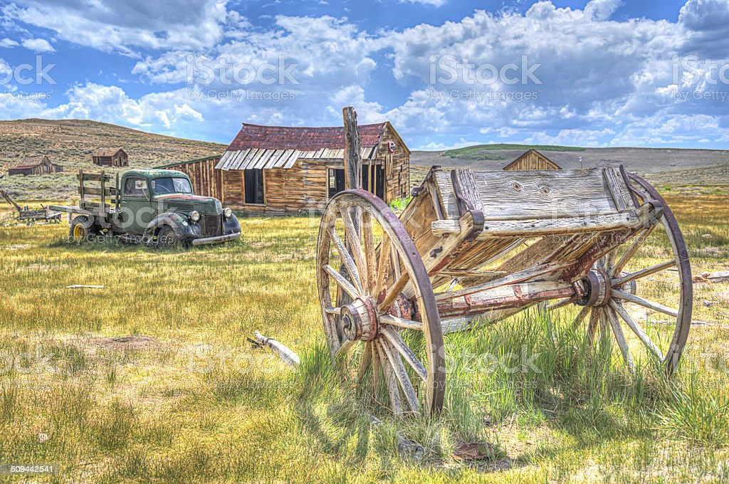 HDR image of abandoned rusty truck  and wooden cart California stock photo