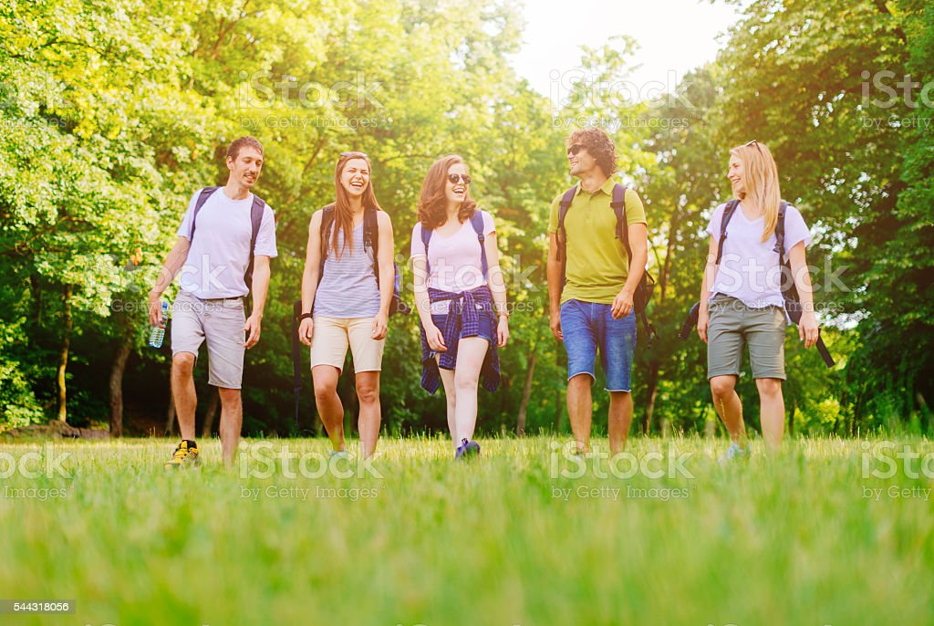 Image of active people in nature, hiking and smiling stock photo