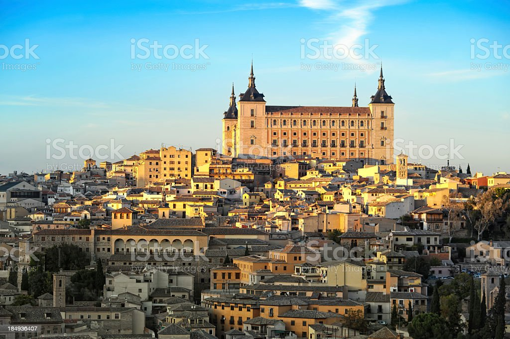 Image of Alcazar with half of town lit by the sun stock photo