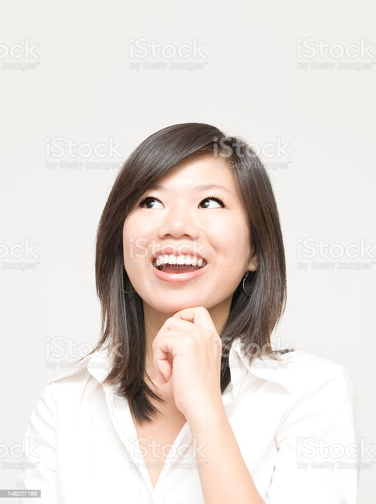 Image of an Asian woman thinking with her hand on chin  royalty-free stock photo