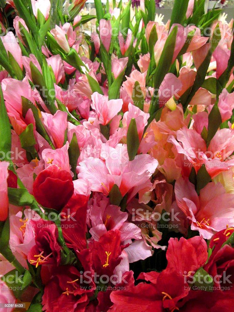Image of artificial plastic / silk gladioli / bright pink gladiolus flowers stock photo