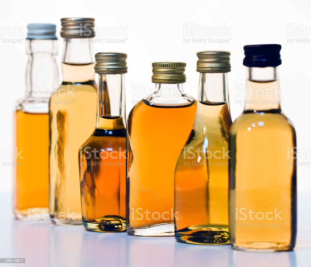 Image of assorted alcohol bottles stock photo