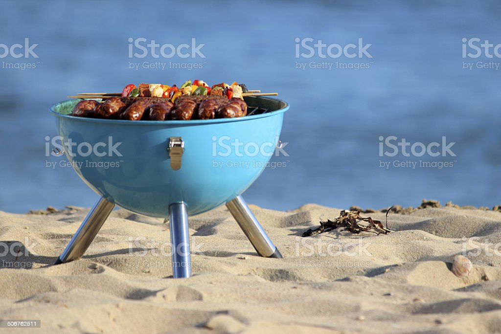Image of beach barbecue, seaside BBQ, sausages, burgers, kebabs stock photo