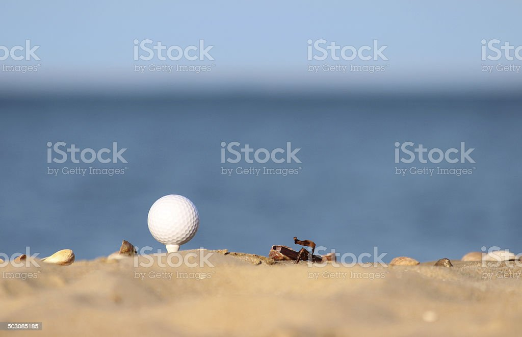 Image of beach golf / golf ball on sandy seaside beach royalty-free stock photo