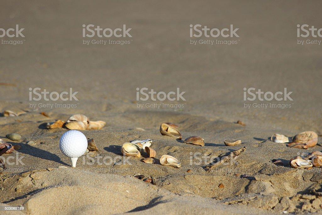 Image of beach golf / golf ball on sandy seaside beach stock photo