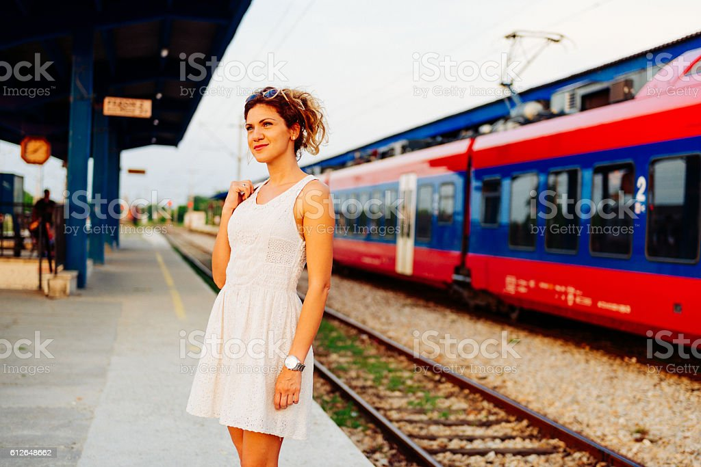 Image of beautiful woman in casual dress on railway station stock photo