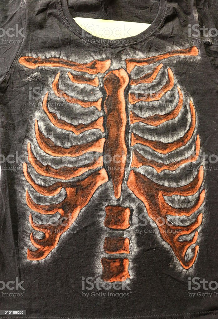 Image of black t-shirt with handcrafted, bleached, skeleton ribcaged design stock photo