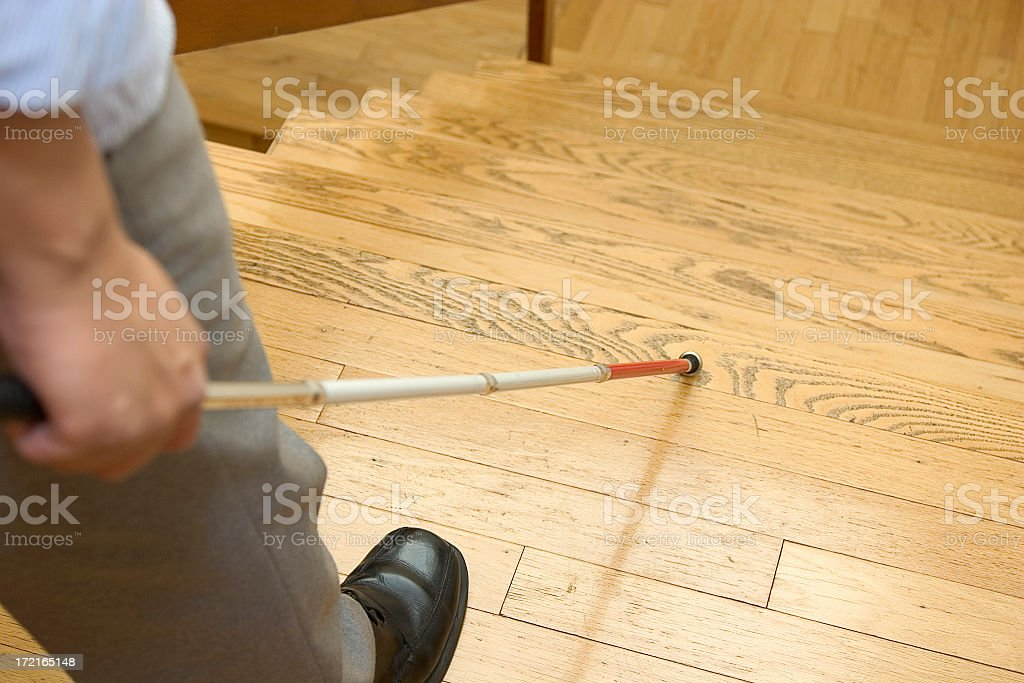 Image of blind man with walking stick about to go downstairs stock photo