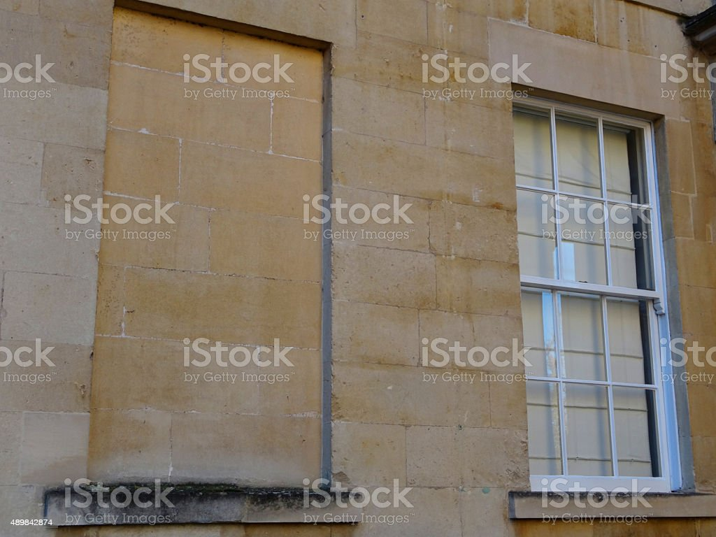 Image of blocked-up window on historic Georgian house, window tax stock photo
