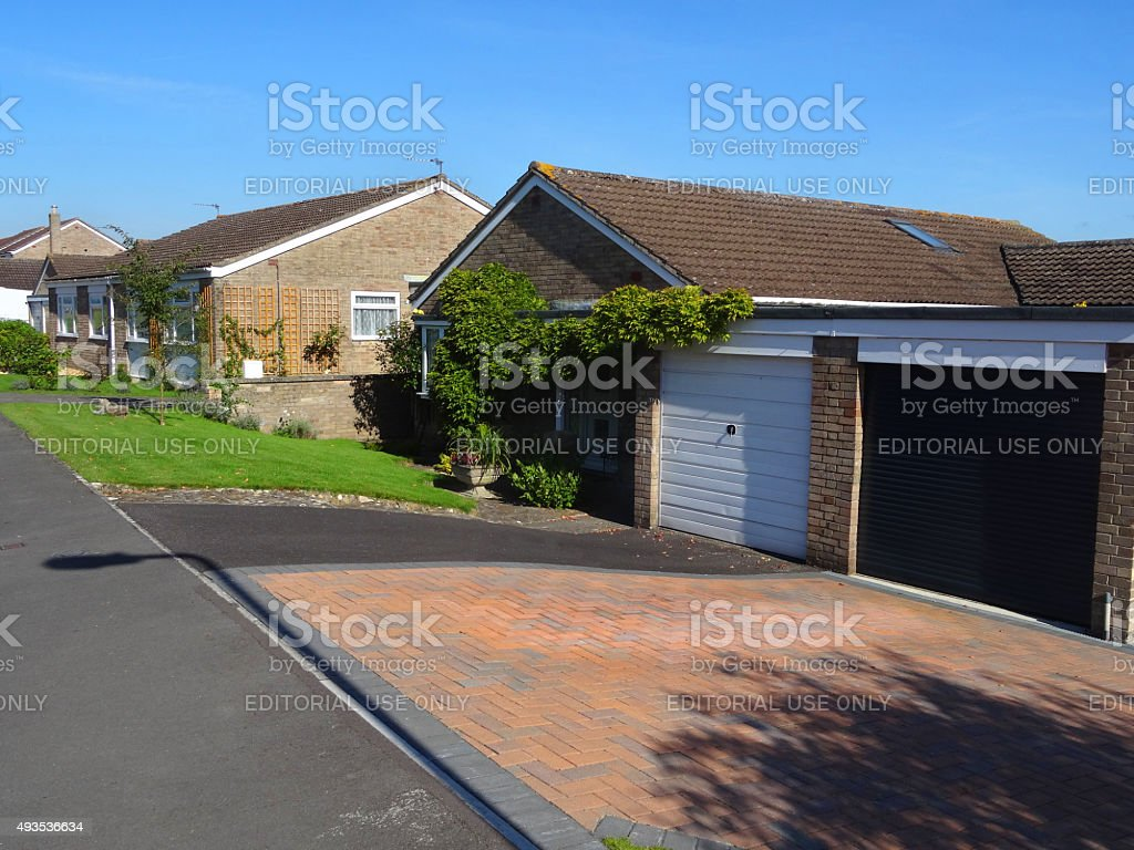 Image of block-paved driveways on housing estate with bungalows / pavement stock photo