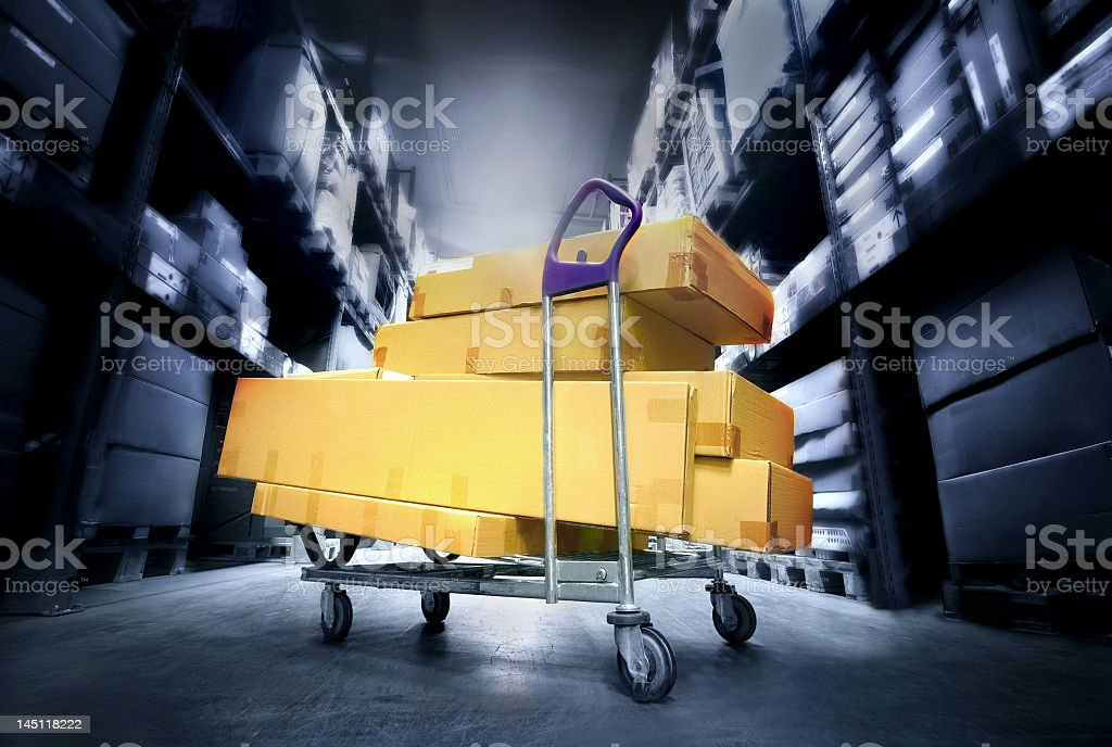 Image of boxes piled on a dolly in a warehouse royalty-free stock photo