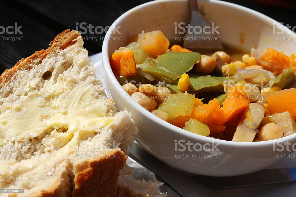 Image of bread and butter with bowl vegetable, chickpea stew, stock photo