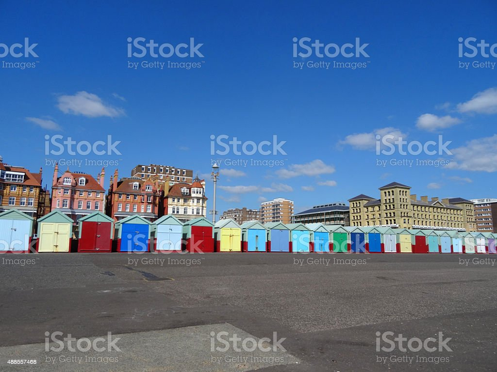 Image of brightly coloured beach huts lining Brighton seaside promenade stock photo