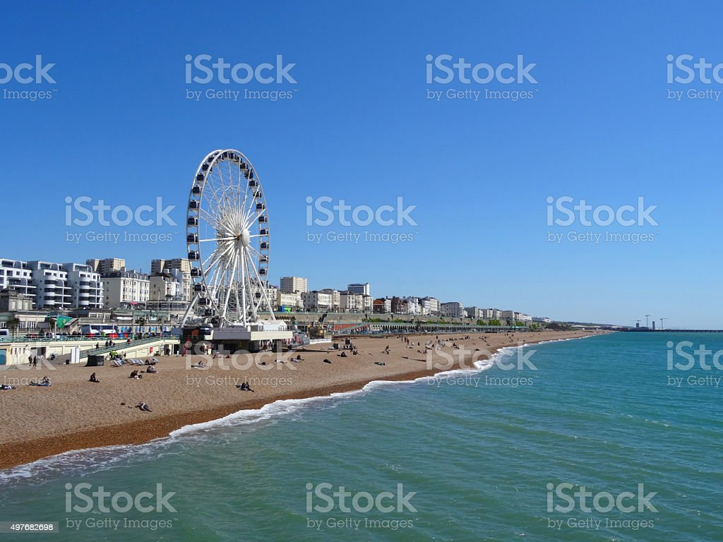 Image of Brighton beach with Big Wheel, grand hotels, blue-sky stock photo