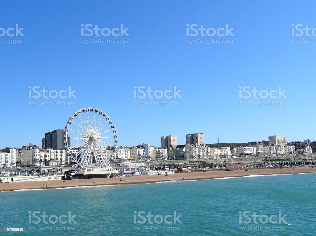 Image of Brighton wheel attraction, sunny beach and coastline panorama stock photo