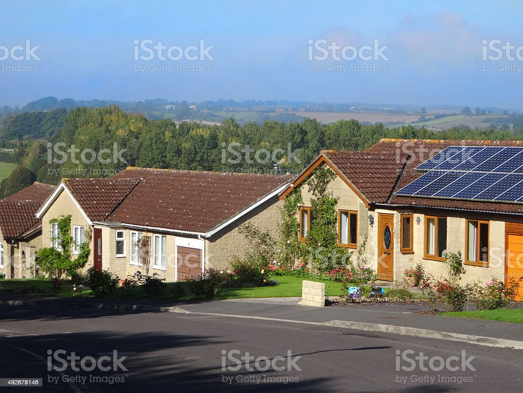 Image of bungalows with solar panels of roofs, countryside views stock photo