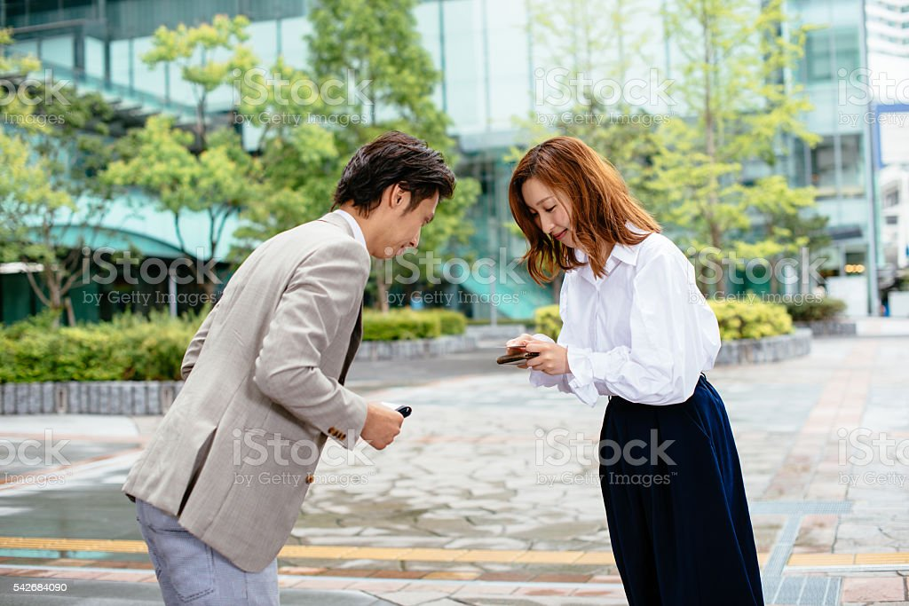 Image of business people exchange business cards and handshake stock photo