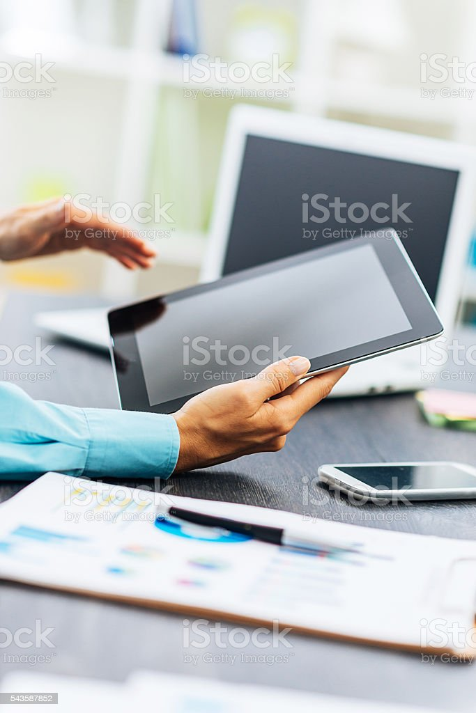 Image of business person in office reading financial news stock photo