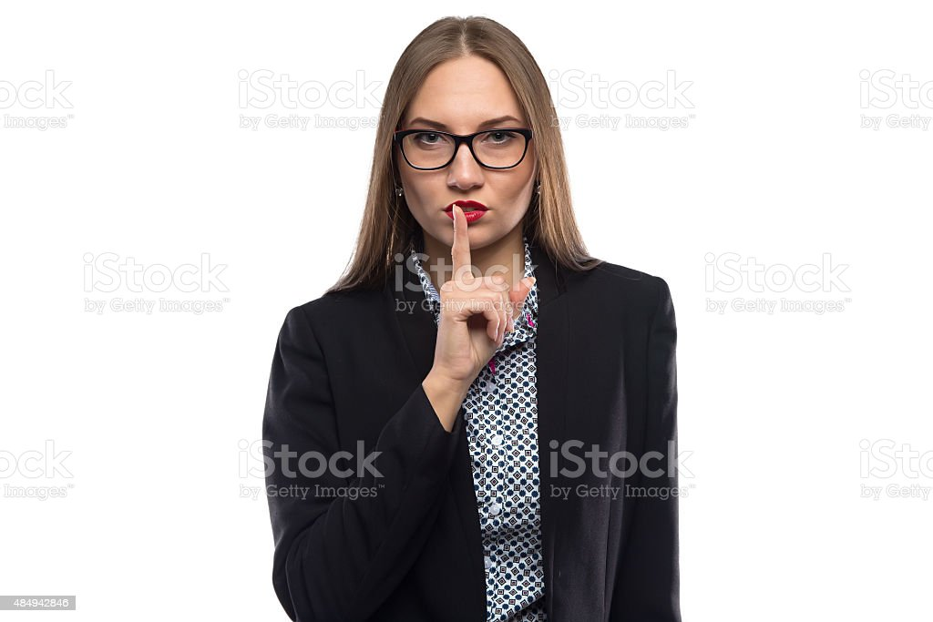 Image of businesswoman showing silence in glasses stock photo