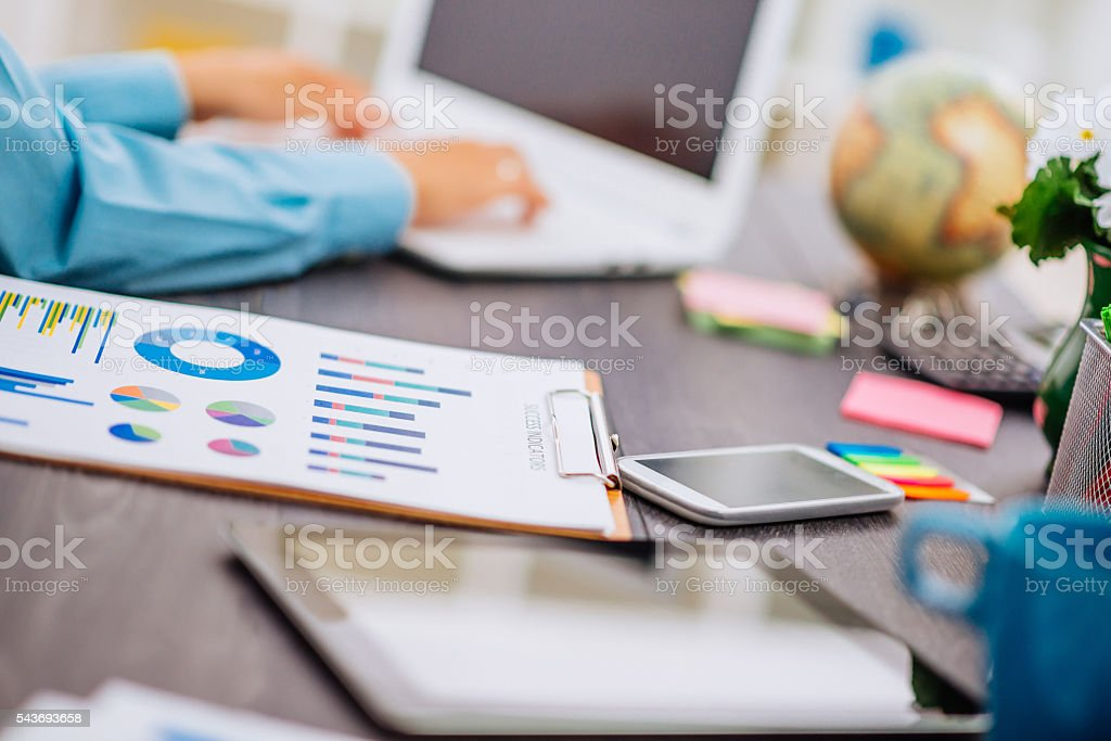 Image of businesswoman typing on laptop in modern office stock photo