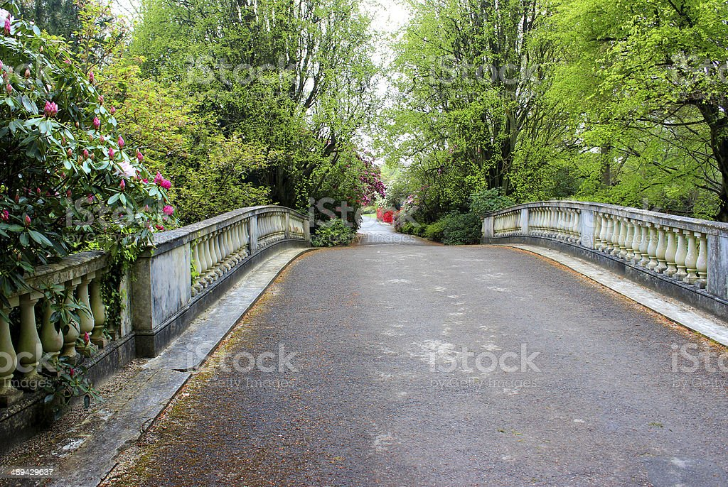 Image of cast stone balustrading on ornamental garden bridge stock photo