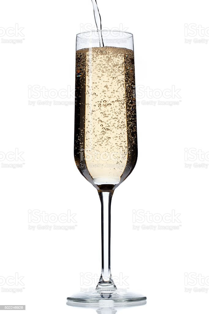image of champagne falling in champagne flute stock photo