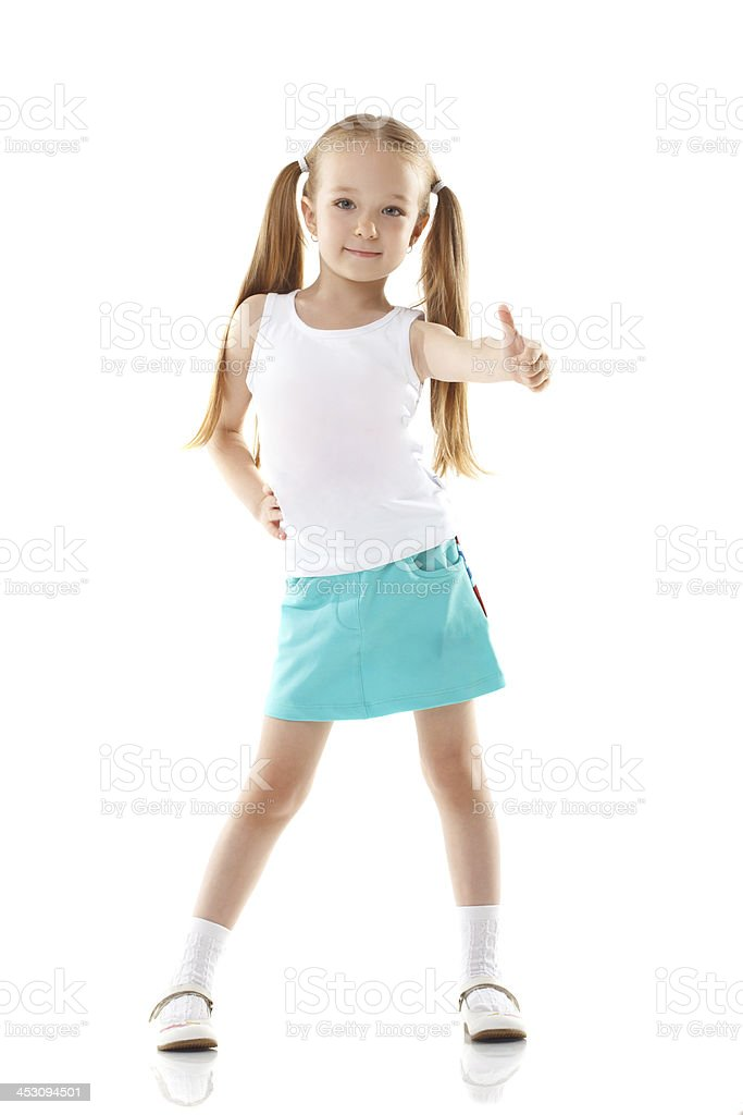Image of charming little girl showing thumbs up royalty-free stock photo