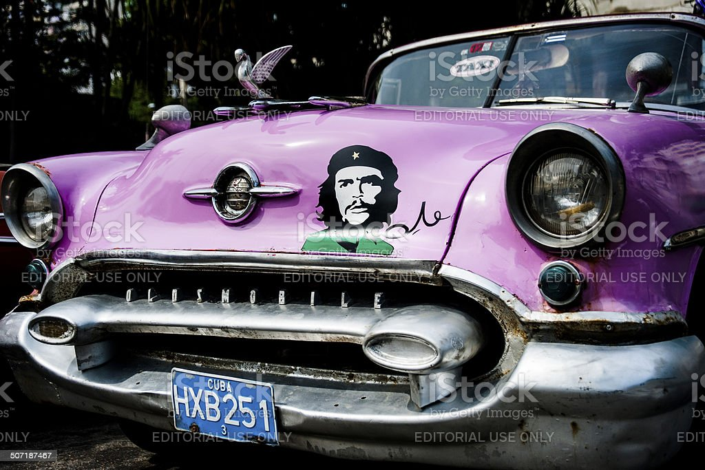 Image of Che Guevara on vintage Cuban Oldsmobile taxi stock photo