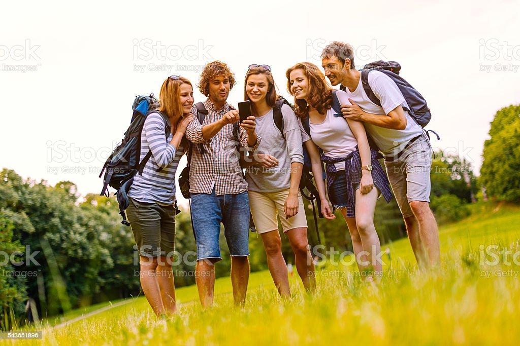 Image of cheerful nature explorers using GPS stock photo