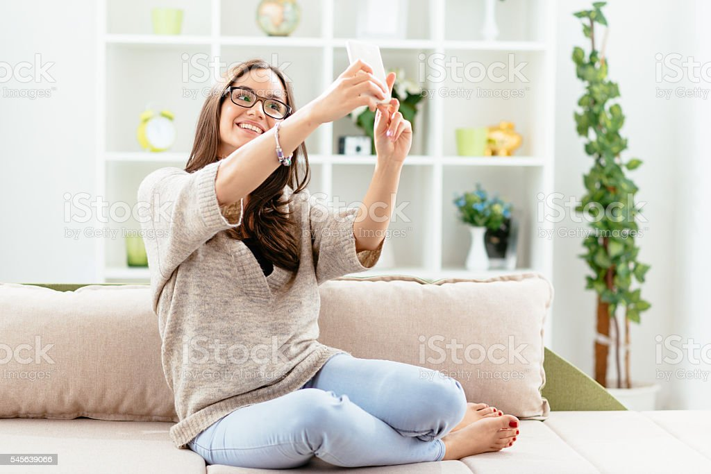 Image of cheerful woman taking selfie shot and smiling stock photo