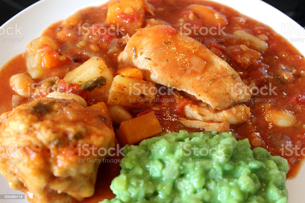 Image of chicken casserole meal with mushy peas, vegetables, gravy royalty-free stock photo