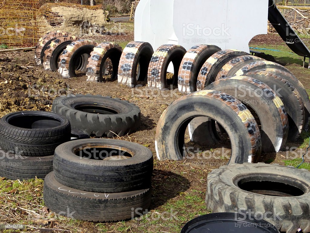 Image of children's playground with tunnel made from tractor tyres stock photo