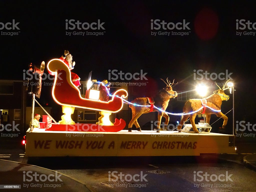Image of Christmas carnival float with Santa Claus and reindeer stock photo