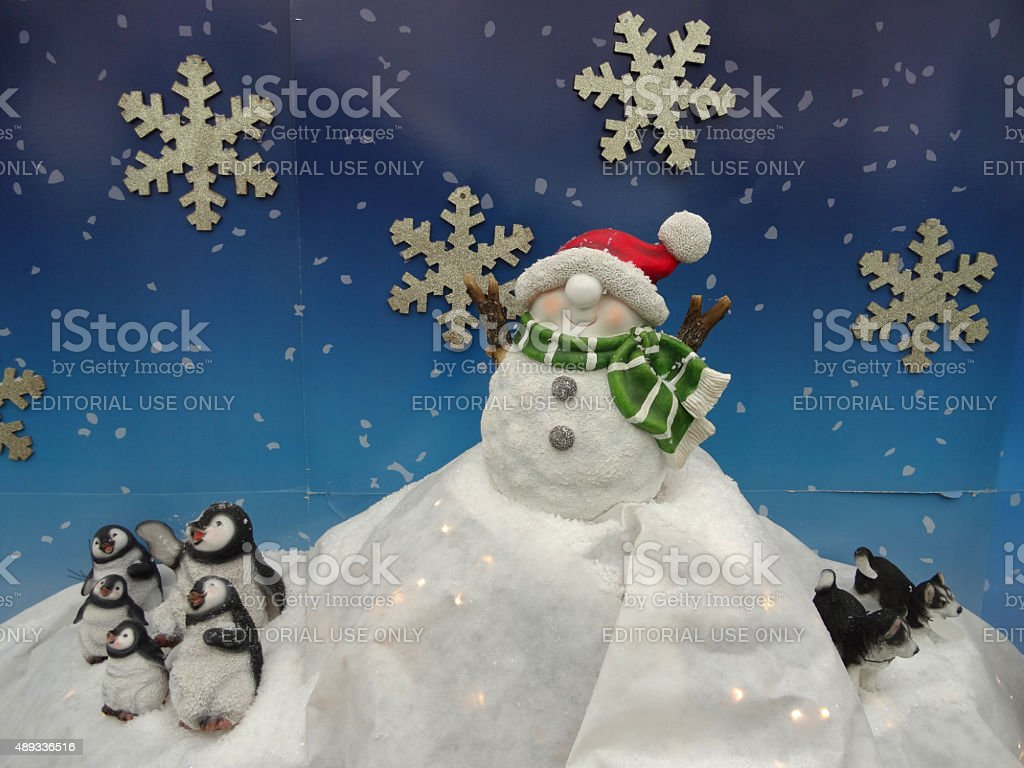 Image of Christmas display of snowman toy, penguins and husky-dogs stock photo