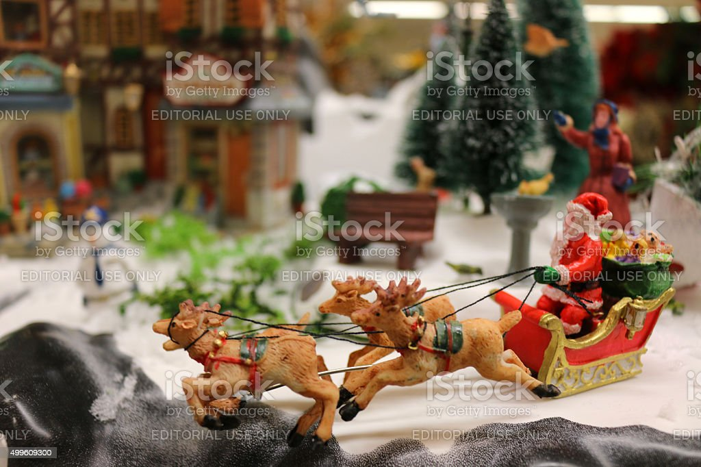 Image of Christmas model Santa Claus with toy reindeer sleigh stock photo