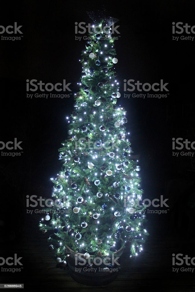 Image of Christmas tree at night, white led, fairy lights stock photo