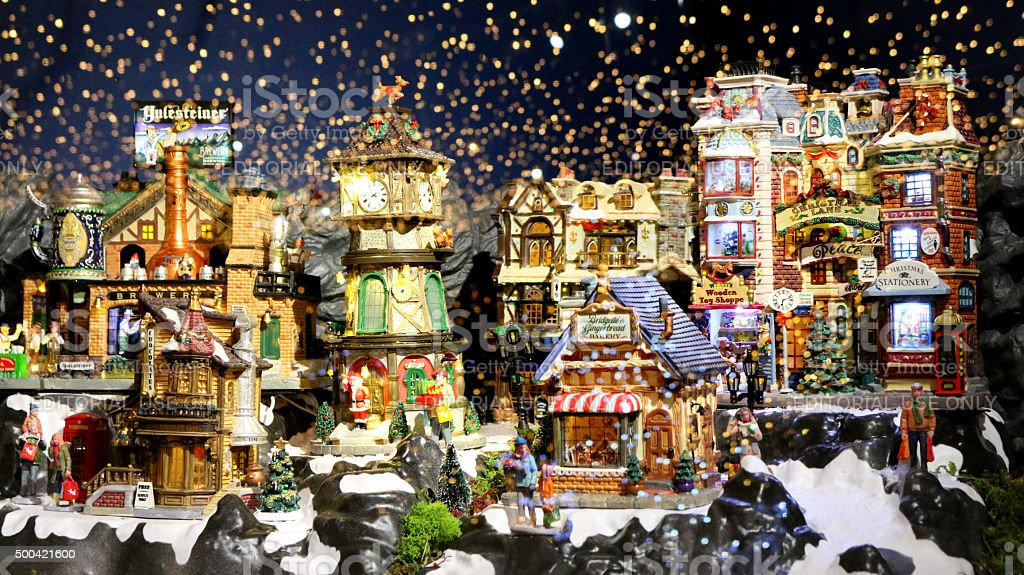 Image of Christmas village model scene, sky of twinkling stars stock photo