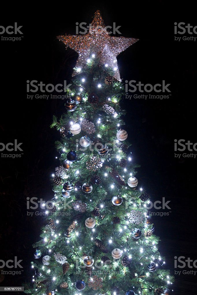 Image of Christmas-star tree topper decoration - night background, bokeh stock photo