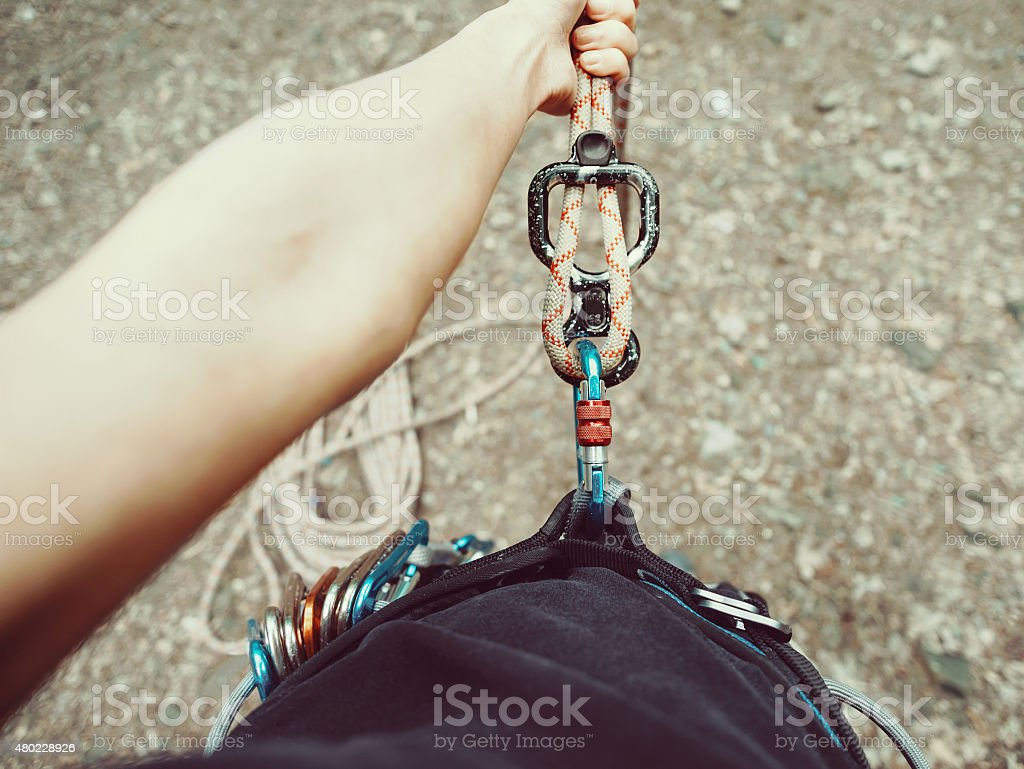 POV image of climber woman in harness stock photo