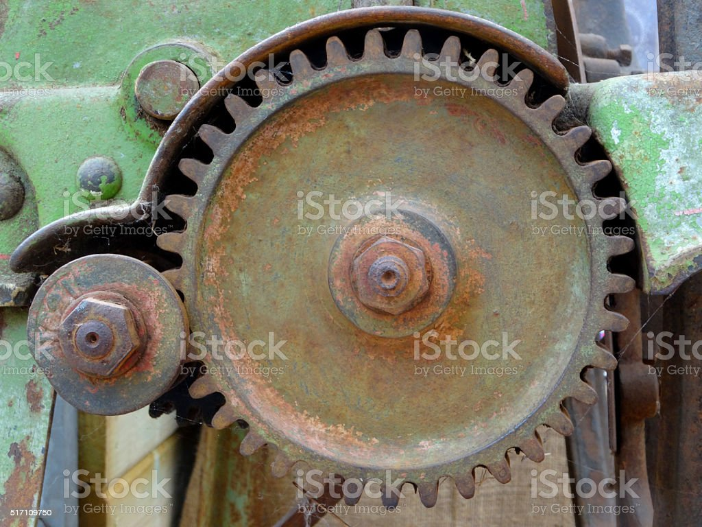 Image of close up straight-cut gears, weathered agricultural machinery stock photo