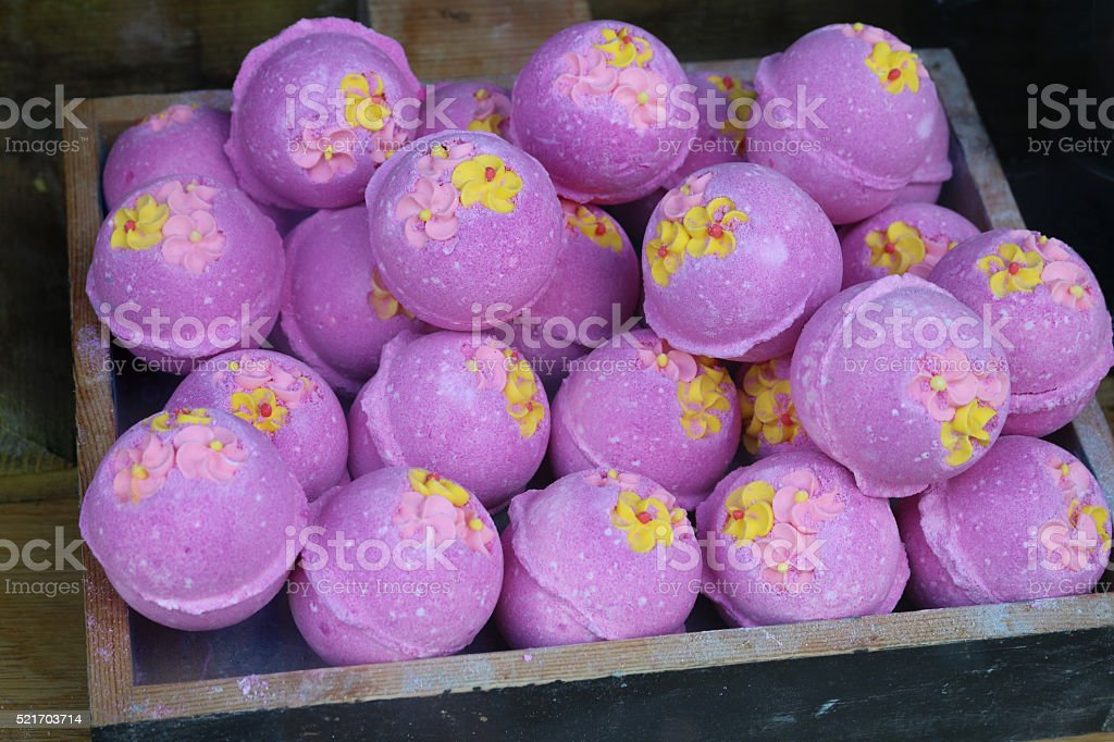 Image of close-up display of pink spherical fizzy bath bombs stock photo