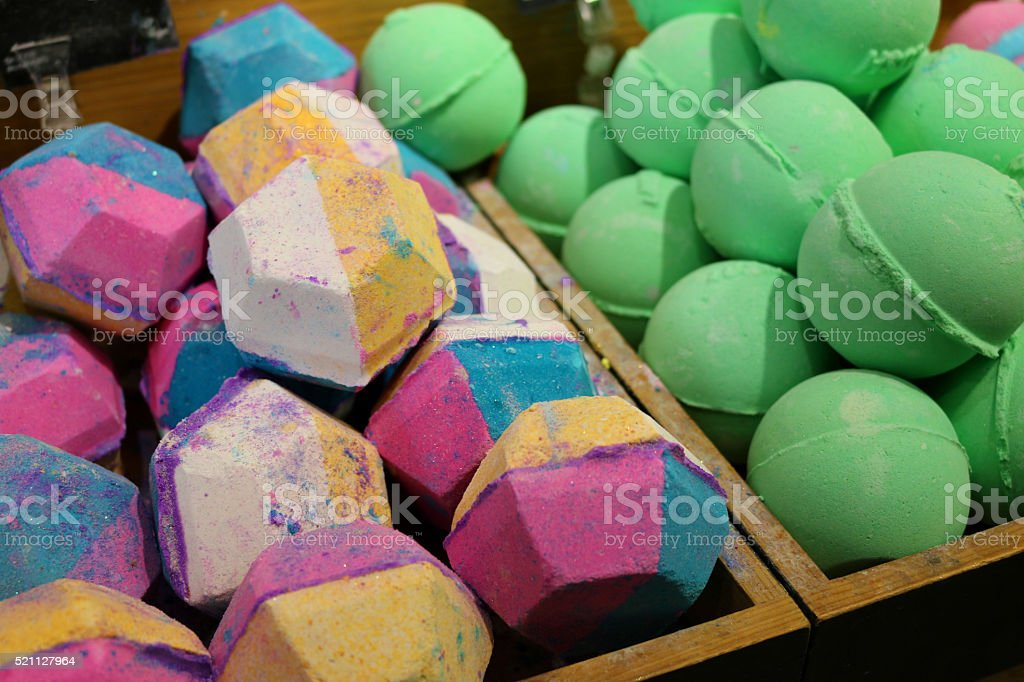 Image of close-up display of spherical and hexagonal bath bombs stock photo