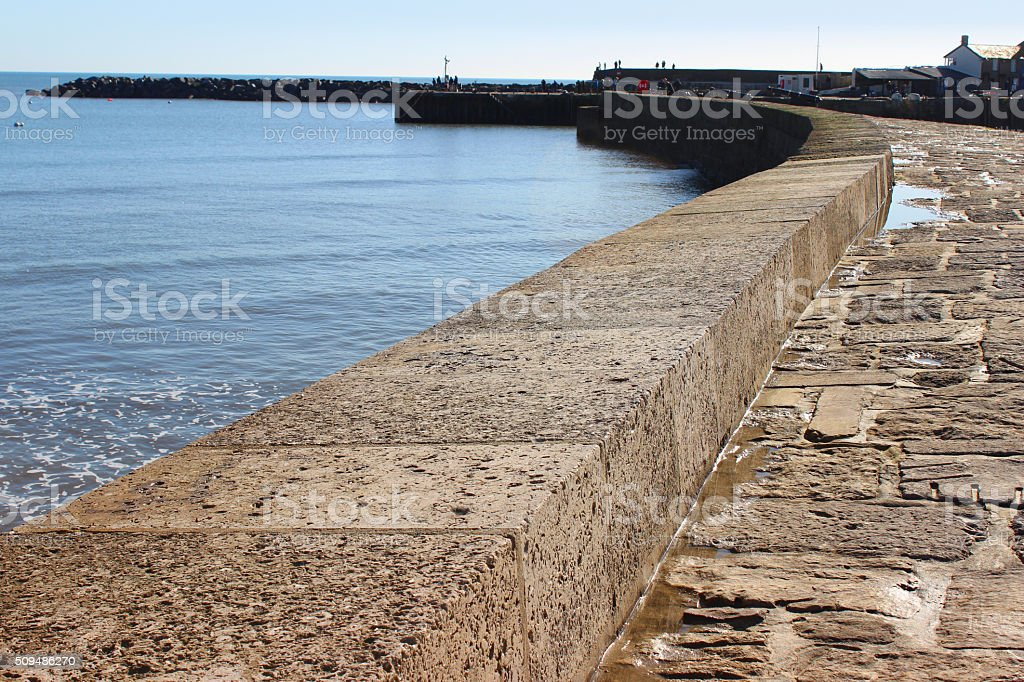 Image of coastal defence, harbour wall promenade holding back sea stock photo