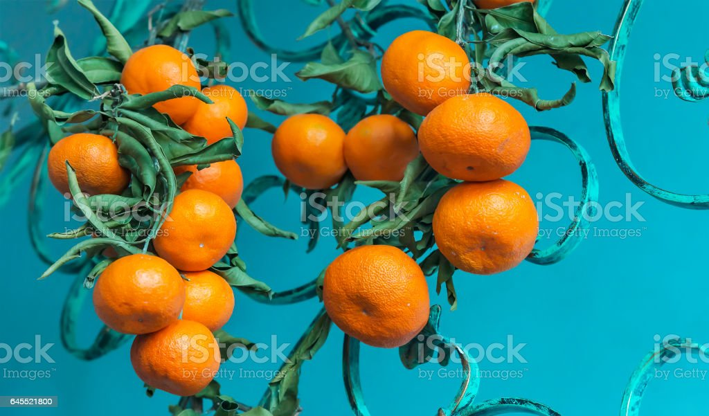 Image of colorful tangerine clusters on a blue background stock photo