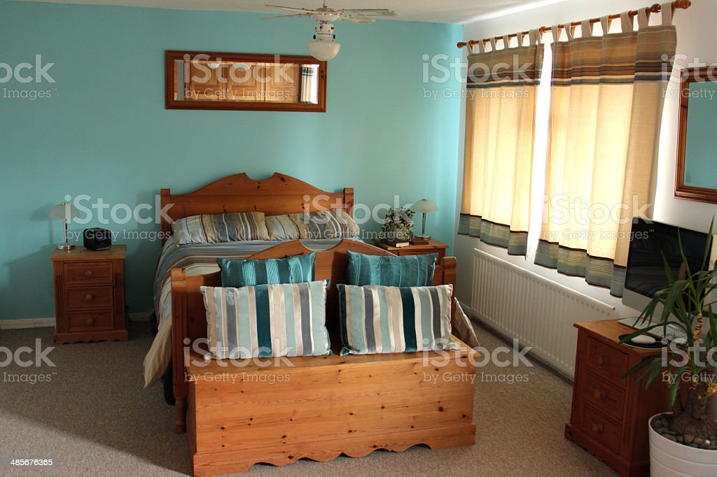 Image of colour coordinated bedroom suite with pine bed furniture royalty-free stock photo