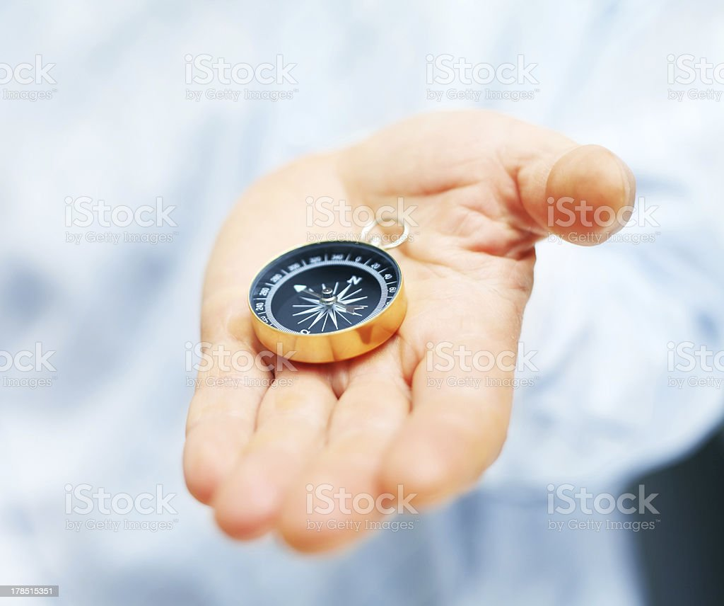 Image of compass in businessman hand stock photo