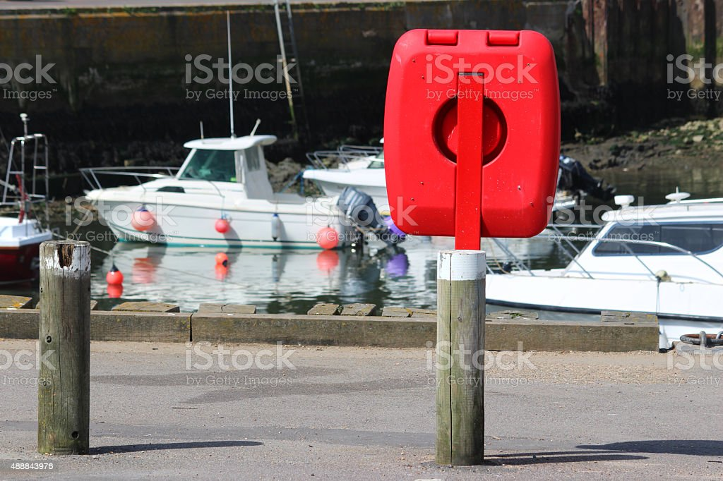 Image of containerised lifering / red lifebuoy donut ring by marina stock photo