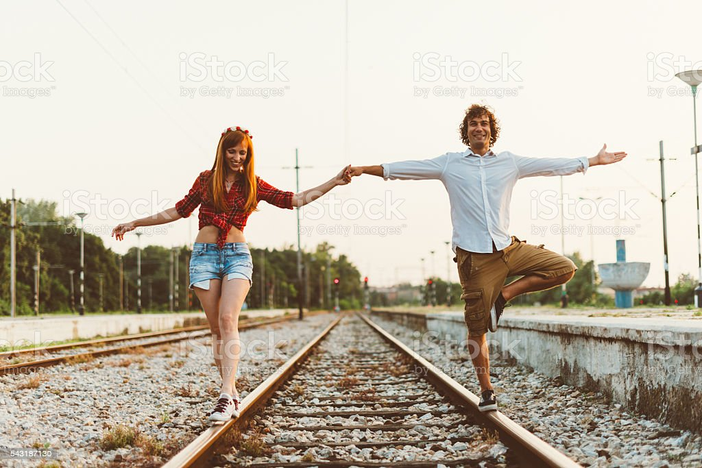 Image of couple heading to unknown direction in summer stock photo